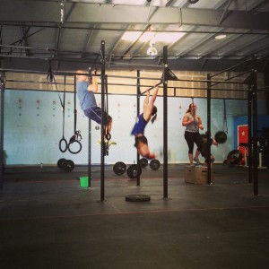 Mike B and Jen C getting their pull-ups done during the killer thruster/c2bwod on Saturday